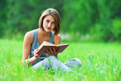 Girl - student reads book Stock Photos