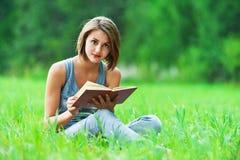 Girl - student reads book Stock Photos