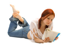Girl-student reads the book Royalty Free Stock Photography