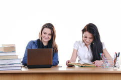 Girl student reads a book at the table Royalty Free Stock Images