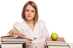Girl student reads books Royalty Free Stock Image