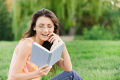 Girl-student reads textbook. Royalty Free Stock Photography
