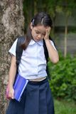 Girl Student And Sadness Wearing Uniform With Books