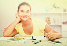 Girl student sitting and studying indoors Stock Image