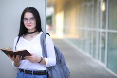 Girl student on the street with books stock images