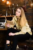 Girl student study with book in house of gamekeeper. Study concept. Lady on calm face in plaid clothes looks cute and. Casual. Girl in casual outfit sits with royalty free stock photos