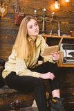 Girl student study with book in house of gamekeeper. Study concept. Lady on calm face in plaid clothes looks cute and. Casual. Girl in casual outfit sits with stock image
