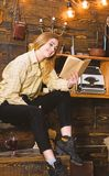 Girl student study with book in house of gamekeeper. Study concept. Lady on smiling face in plaid clothes looks cute and. Casual. Girl in casual outfit sits royalty free stock photography