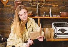 Girl student study with book in house of gamekeeper. Girl in casual outfit sits with book in wooden vintage interior. Study concept. Lady on calm face in plaid stock images