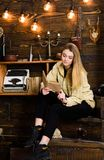 Girl student study with book in house of gamekeeper. Lady on calm face in plaid clothes looks cute and casual. Study. Concept. Girl in casual outfit sits with stock photos