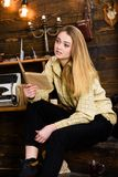 Girl student study with book in house of gamekeeper. Lady on calm face in plaid clothes looks cute and casual. Girl in. Casual outfit sits with book in wooden royalty free stock photos