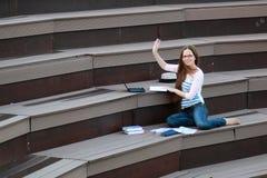 Girl student study homework outdoor Stock Photo
