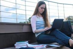 Girl student study homework outdoor Royalty Free Stock Photo