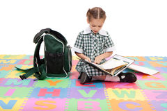 Girl student studying school homework reading book. School girl reading school homework book in folder. Isolate on white Royalty Free Stock Photography