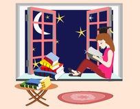 Girl student studying and sitting on the windowsill Royalty Free Stock Image