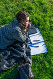 Girl / student studying / smiling on a green grass lawn Royalty Free Stock Photos
