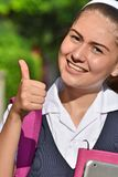 Girl Student With Thumbs Up Wearing School Uniform With Books
