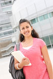 Girl Student Walking on the College Campus Stock Images