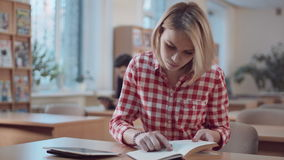 Girl student working with book and tablet stock video