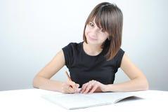 Girl student writes Royalty Free Stock Image