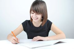 Girl student writes Stock Images