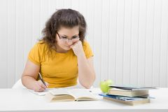 The girl the student with writing-books and books Stock Photo