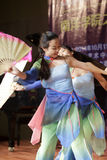 Girl students perform folding fan dance Royalty Free Stock Image