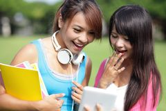 Girl students using tablet pc royalty free stock image