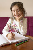Girl studies. With a cute smile stock photography