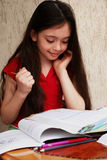 Girl studies math. With a enjoyment royalty free stock photo