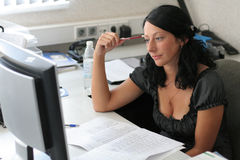 Girl studies and thinks Stock Image