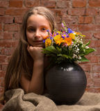 Girl in studio with flowers Royalty Free Stock Photo