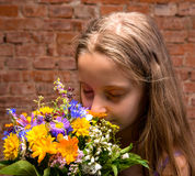 Girl in studio with flowers Royalty Free Stock Image