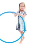 Girl studio photo. Little girl with hoop in hand.Isolated on white background stock photo