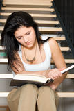 Girl study. With the book on the stairs Stock Images