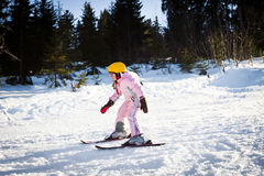 Girl study skiing. In pink suit Stock Images