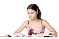 Girl studying. Photo of a female student doing homework Royalty Free Stock Photos
