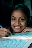 Girl studying. An adolescent girl from the slum of Tanagra is happy to get scope of education, east Kolkata, west Bengal, India Royalty Free Stock Photos
