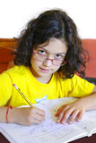 Girl Studying. Concentrated young girl doing her school homework Royalty Free Stock Images