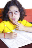 Girl Studying. Concentrated young girl doing her school homework Stock Images