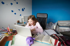 Girl Studying In Bedroom Using Laptop Royalty Free Stock Images