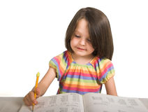 Girl studying from book Royalty Free Stock Photos
