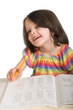 Girl studying from book Stock Image