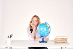 Girl studying at desk Stock Images