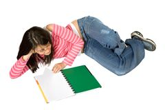 Girl studying on the floor Stock Photos