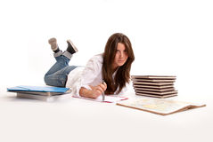 Girl studying on the floor Stock Photography
