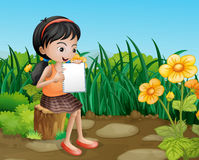 A girl studying at the garden Royalty Free Stock Photos