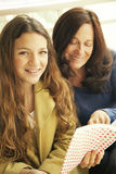 Girl studying with grandmother. Reading a book, back to school Royalty Free Stock Image