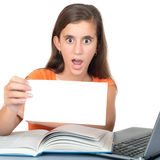 Girl studying and holding a blank sign Royalty Free Stock Photography