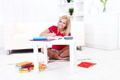 Girl studying  at home Stock Images